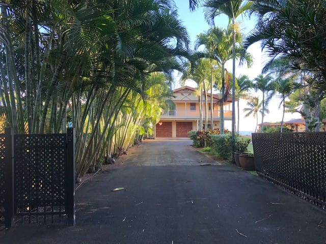 Private drive with gated entry to nearly an acre of lush tropical grounds