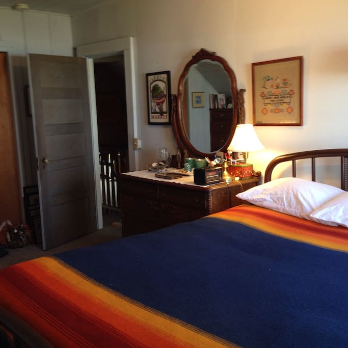 The Blue Room is furnished with a QUEEN size bed, extra blankets & comfy pillows, a dresser, and closet storage space.