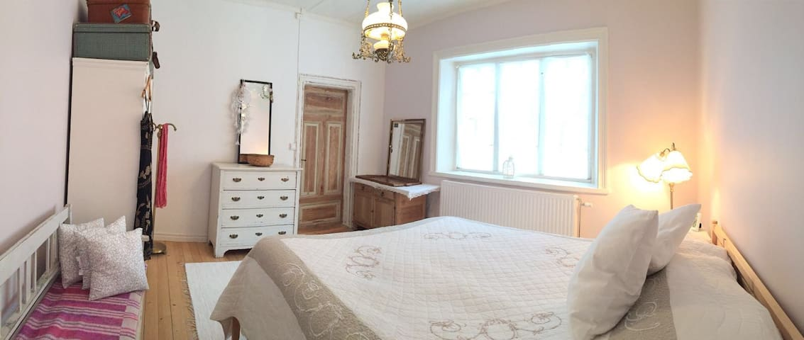 The Master bedroom with its beautiful old window and some authentic furniture.