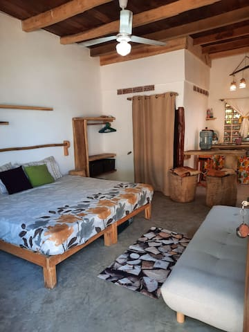 The room features a king-size bed, and a futon sofa bed as well. Comfortable for 1-4 people, maximum of 6. Air mattress available upon request.