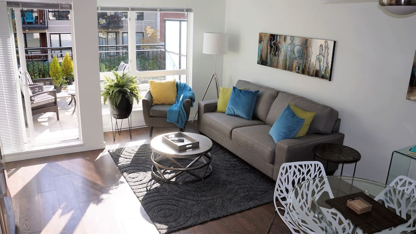 Modern Downtown Condo with Large Sunny Patio