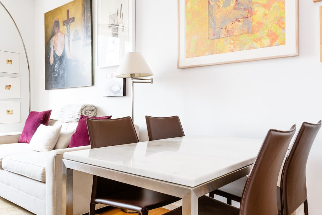 Dining Area: Marble table and four comfortable leather chairs.