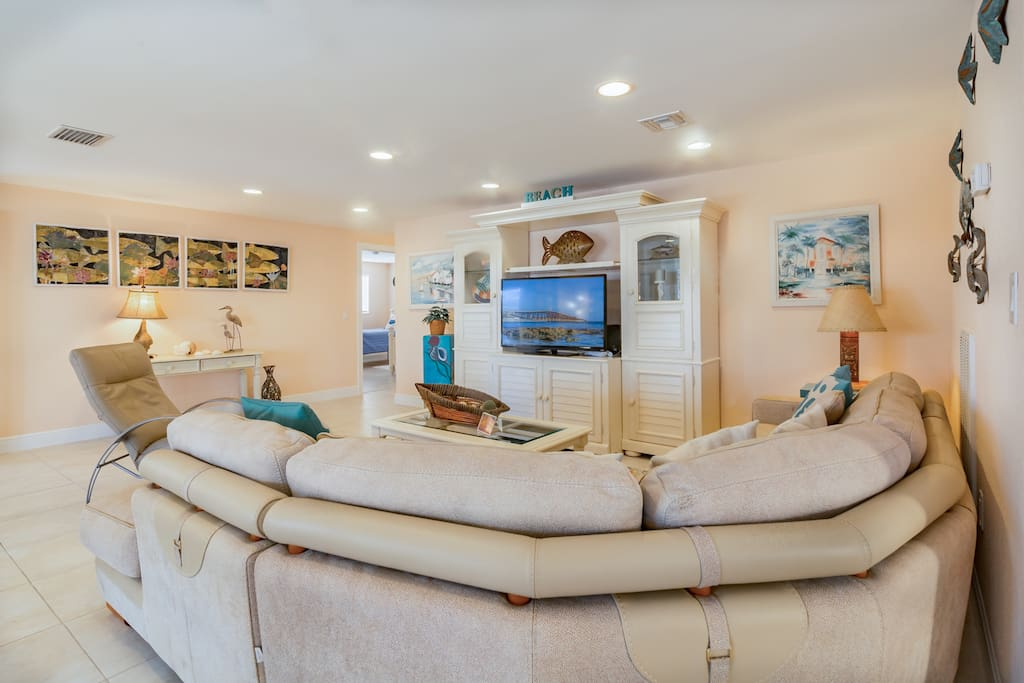 """Living area with seating for 7 and a 47"""" flat screen TV. Complimentary Wi-Fi provided."""