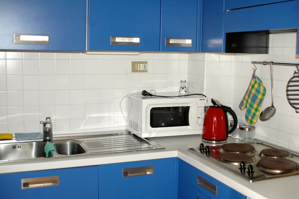 Kitchen with microwave and water boiler