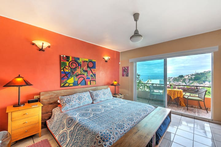 Master Bedroom with king size platform bed and stunning ocean & city views