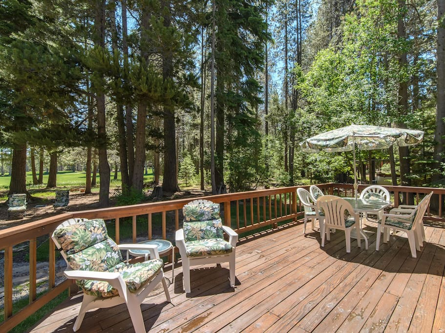 Hang out on the expansive back deck and enjoy the lush greenery and beautiful sunshine.