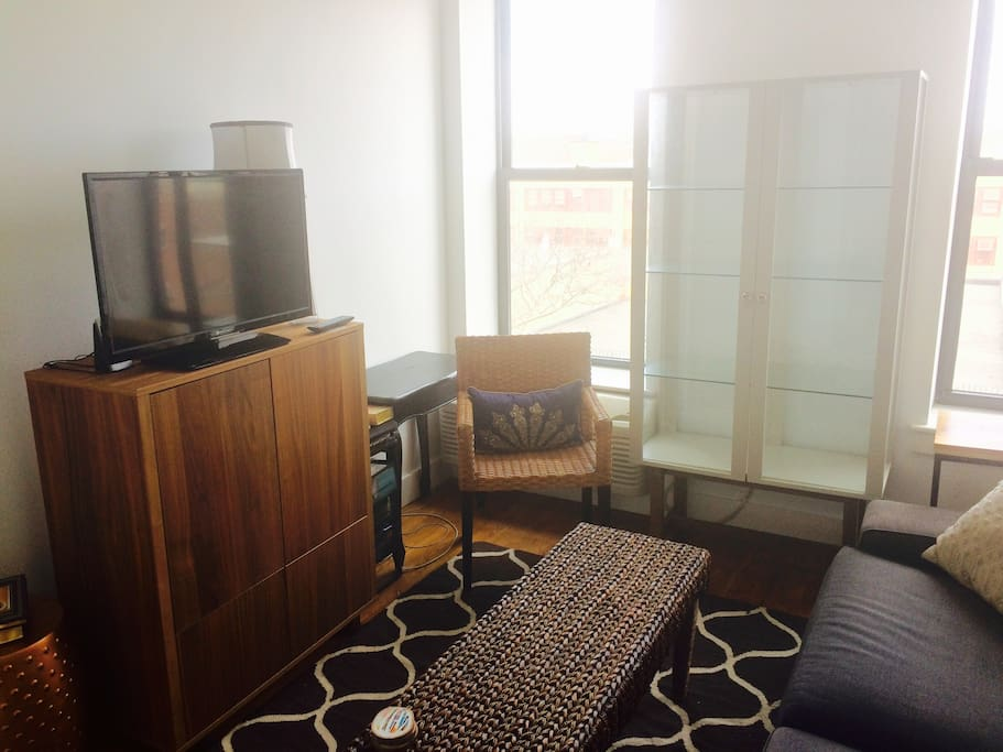 TV, dresser, desk area access.