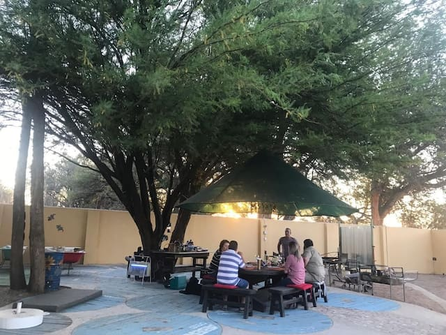 BBQ and dining space under tree