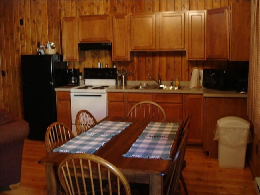 Full kitchen is equipment with microwave, refrigerator, stove, coffee pot, toaster, dishes, pot and pans, silverware. Table seats 6