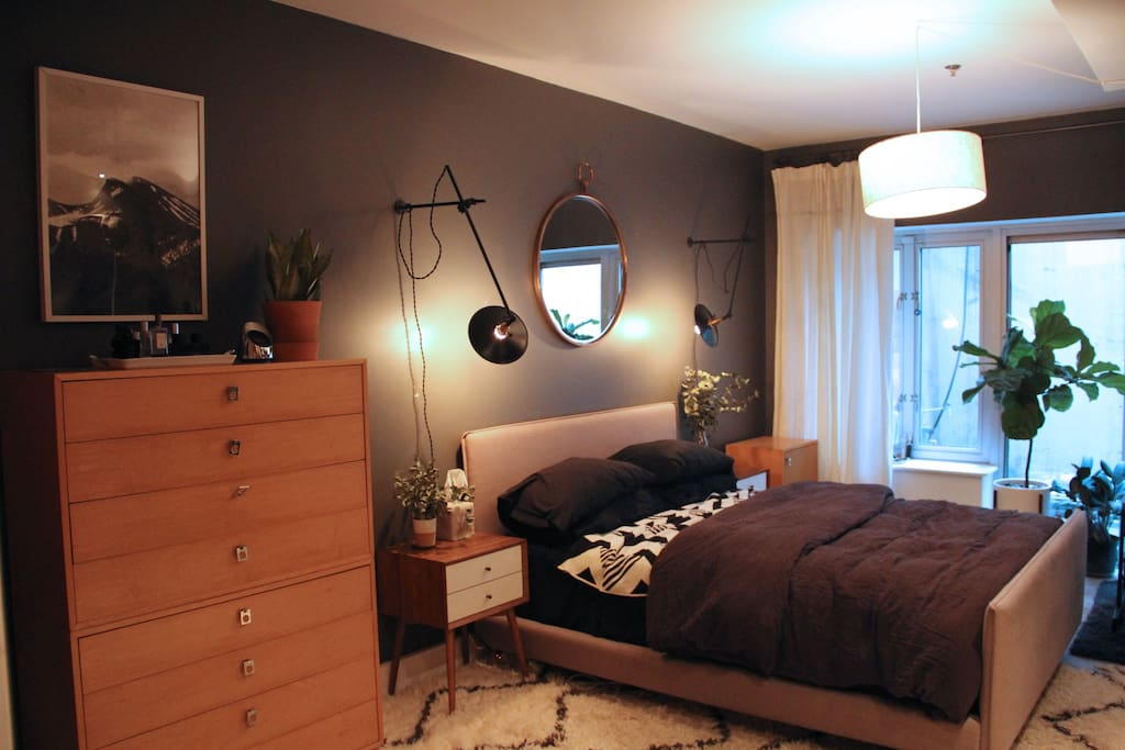 Large master bedroom with Queen size bed on lower level, adjacent to half bathroom and outdoor patio.