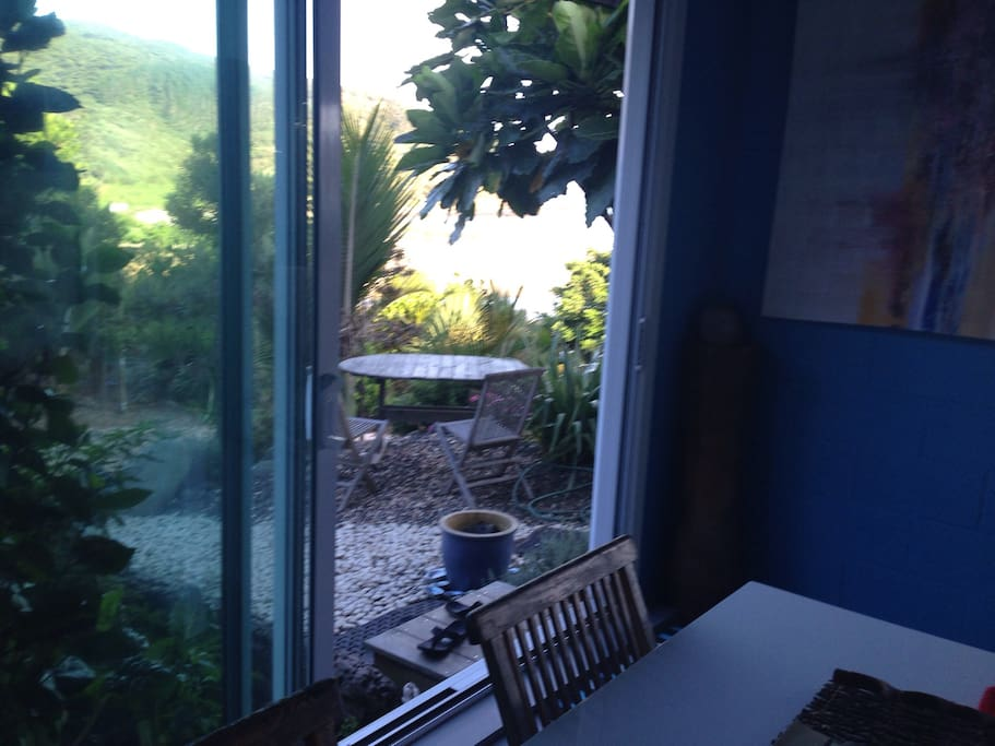 The view is nice  threw  the garden and trees.