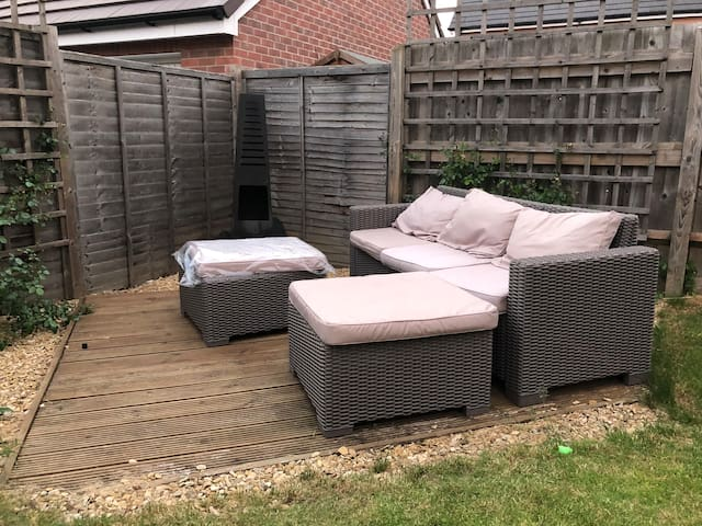 Decking, sofa and wood burner