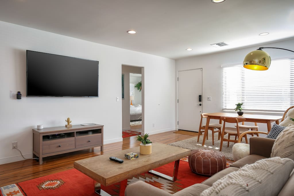 The living room features a flat screen TV with Roku.