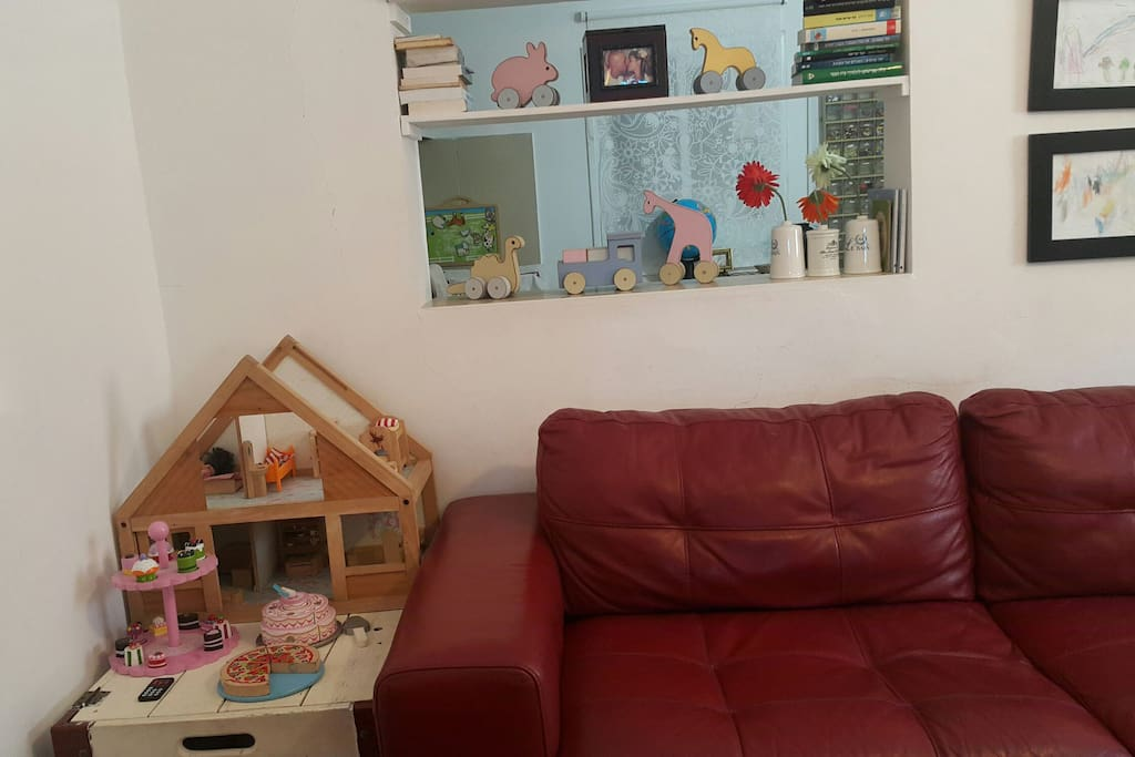 livingroom with dollhouse and wooden cupcakes, pizza & cake