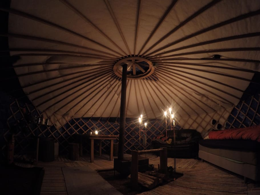 Yurt lit up by candles.