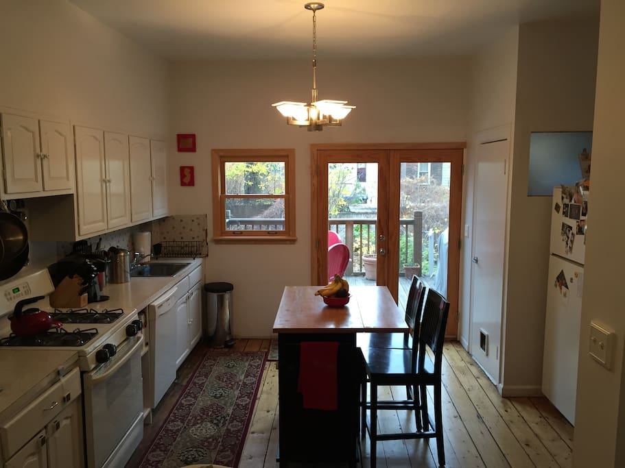 Fully stocked kitchen, island with breakfast bar for 2, and half-bath