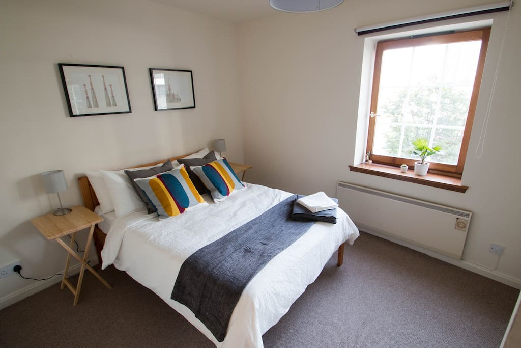 Large main bedroom with a comfortable double bed...