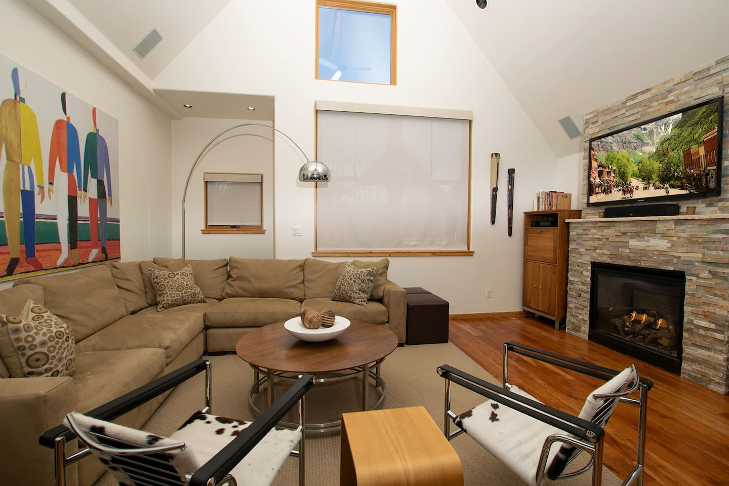The comfortable upstairs living room with surround-sound entertainment center
