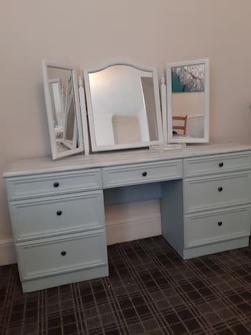 The bedrooms have a vintage feel with lots of storage, hangers and hairdryer, I hope I've thought of everything you will need when you stay at Boundry Cottege