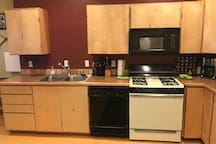 Nice big kitchen with custom cabinets, lots of counter spaces and all the pots and pans and spices and little things you will need to cook up your catch of the day