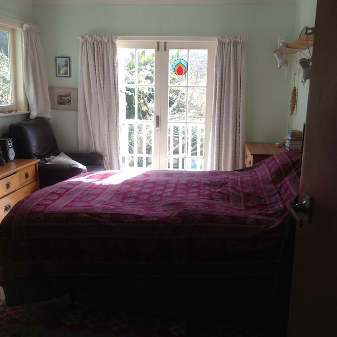 Lovely sunny room with French doors to verandah.