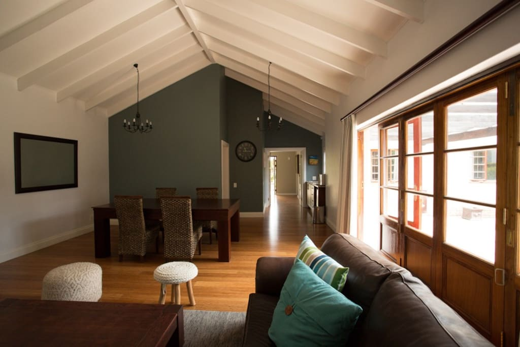 Beautiful high ceilings in the main living area, the epitome of relaxation. A large wooden door opens up to the outside area where you have you own private balcony where you can relax having your morning coffee/tea or afternoon sundowner.