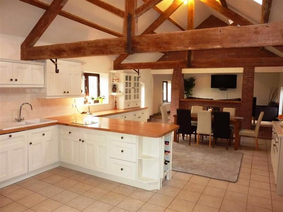 Large kitchen with open beamed ceiling. Lots of character.