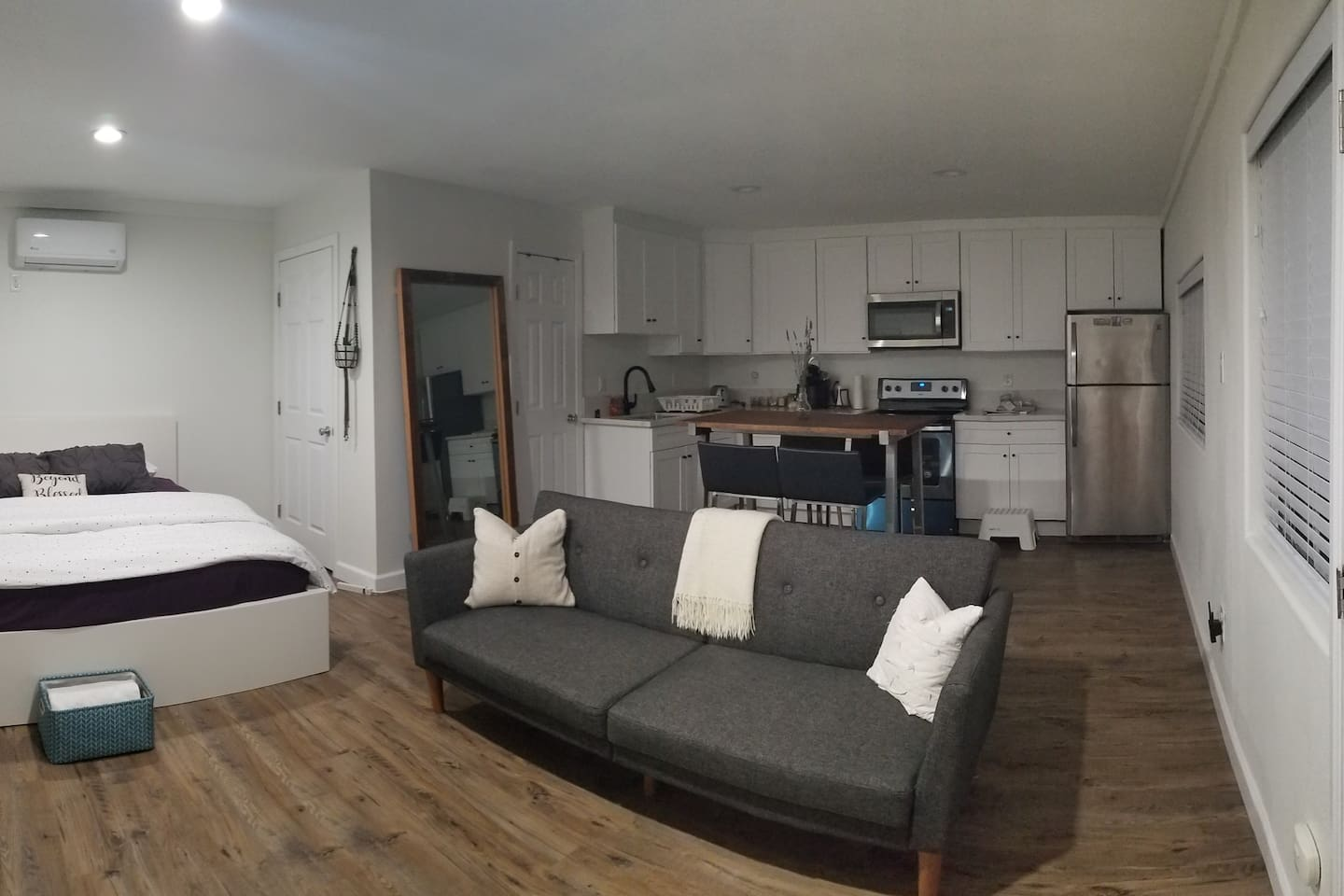 Private suite with own kitchen, bathroom, and living/bedroom space.