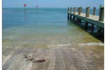 Harry Harris boat ramp. Capable of launching or retrieving any size boat. Just 1.5 miles away.