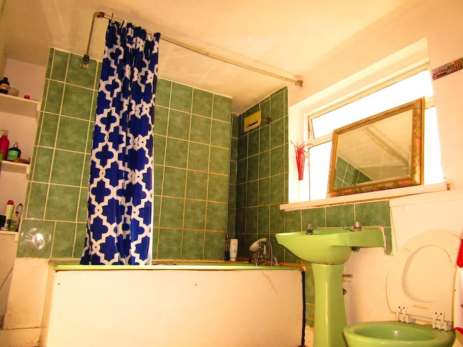 Very spacious bathroom with bath tub and plenty of storage space for you toiletries.