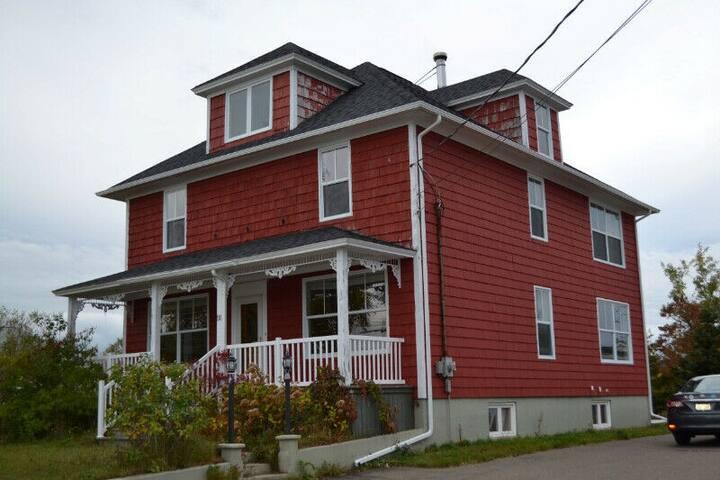 Maison rouge à Lamèque