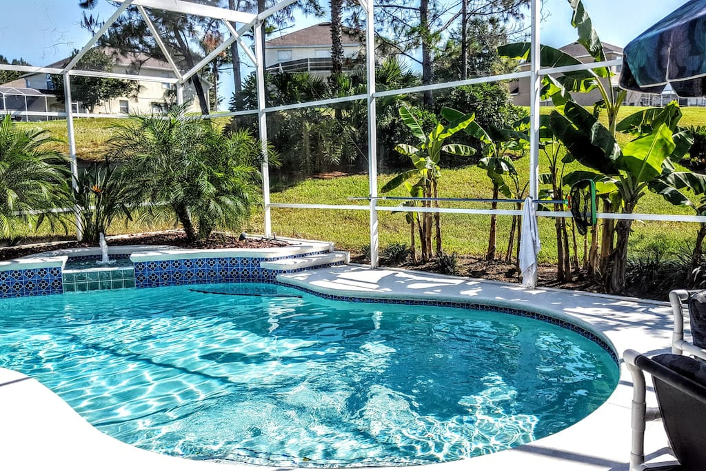 Secluded pool and yard with luxurious tropical planting.