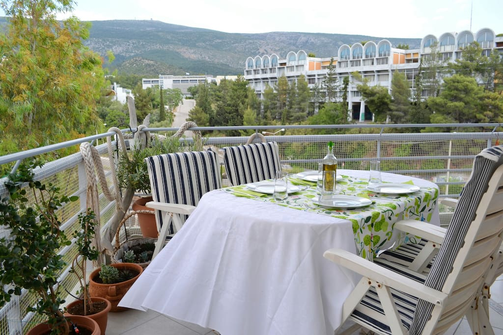 Dining set for your meal on the main-east balcony with splendid view