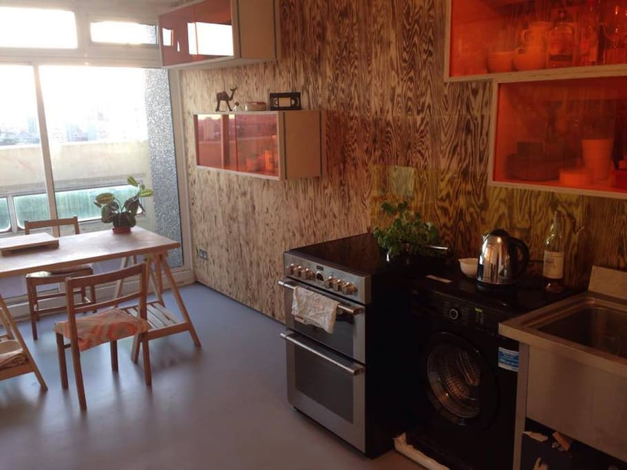 Eat-in kitchen with sliding doors to balcony and beautiful views over London