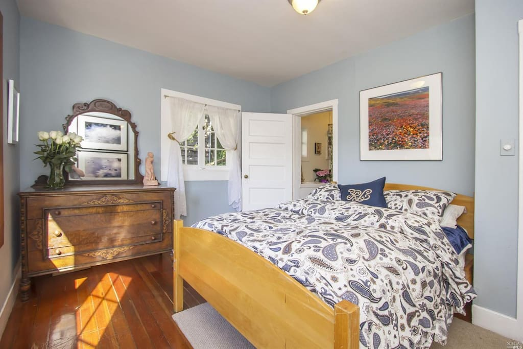 Master Bedroom with a Full bed and access to bathroom (shared)