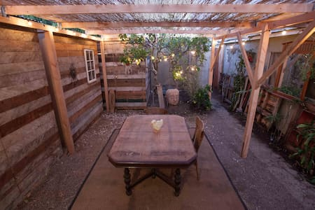 The space was created to be a fun, unique Venice Beach sleeping experience and is a duplicate of my Burning Man Camp room.  We built three private rooms in an extra large space we had in the back of our home. Each room has a rustic wooden door.