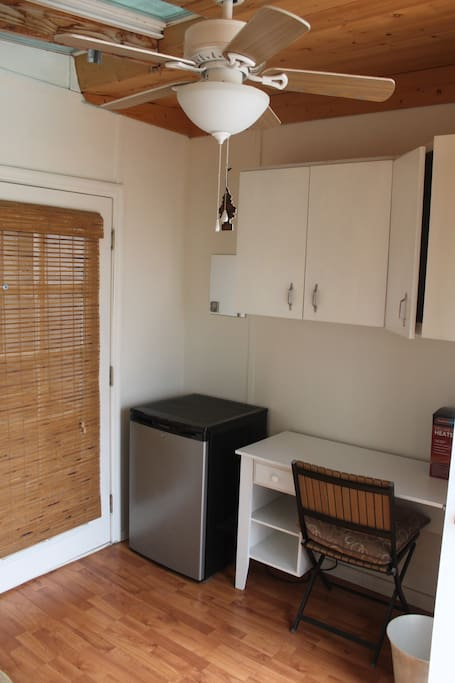 In room refrigerator, work desk and chair, cabinets