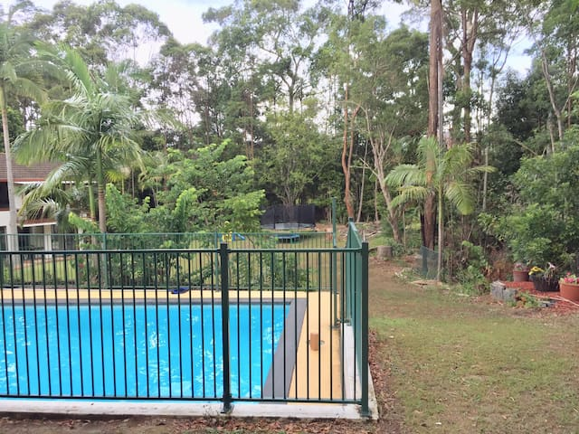 Pool with nature reserve in background