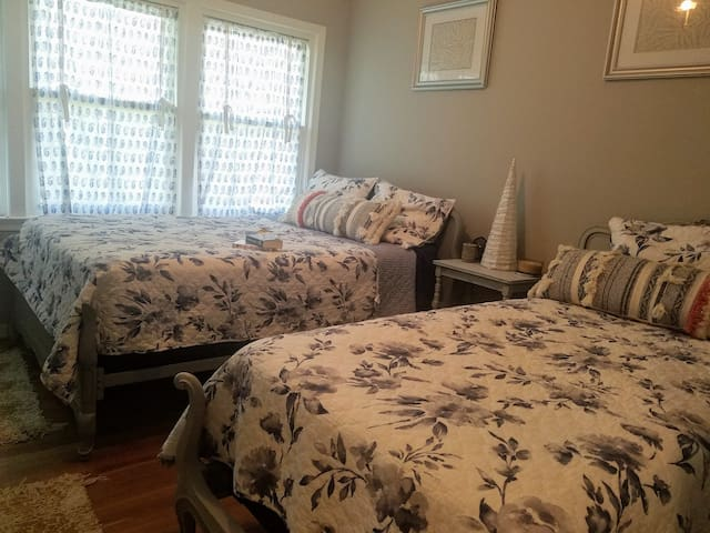 Bedroom #1 - The Silver Fern features 2 twin bed, and closet.