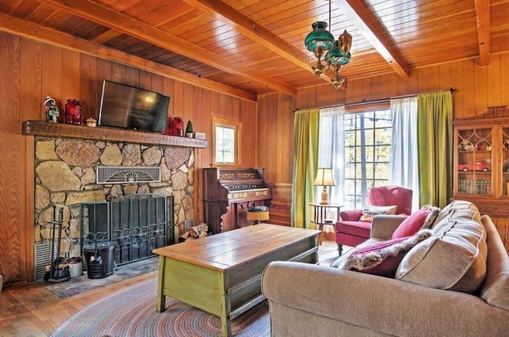 Living Room: Downstairs living room has custom wood burning fireplace, 1890s foot pump piano, TV (Roku & Netflix), dual-pane windows, & coffee table with board games & puzzles. Brand new Tuft & Needle mattress (July 2019) in downstairs master suite!