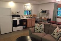 Kitchen, dining, and living areas