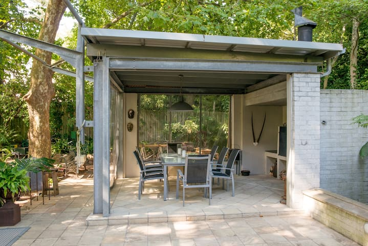 Outside dining area. Barbecue and dine al fresco to the sound of gushing water and views of the mountain