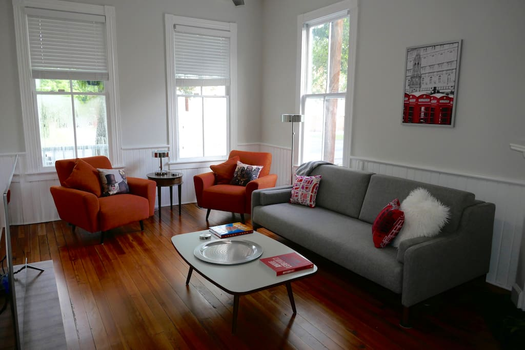 Front living room. Overlooking a park. Refinished original pine floors. AC and fan.