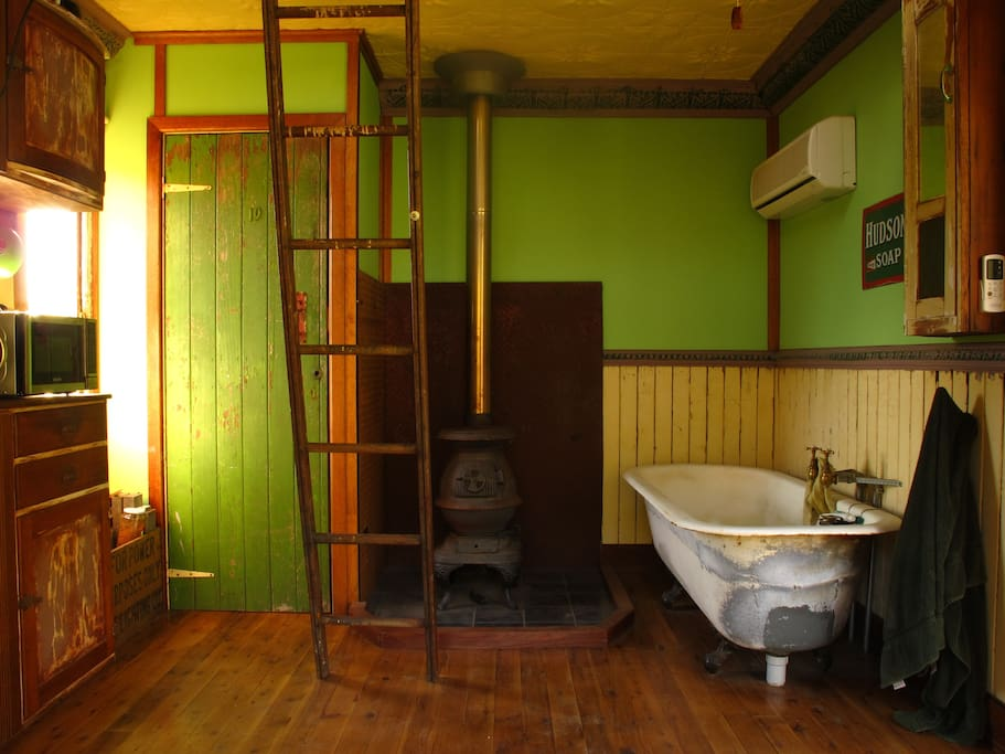 Pot belly stove heater and cast iron bath.