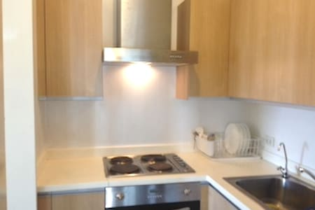 Prime  1BR Condo in BGC furnished, wifi & cable tv