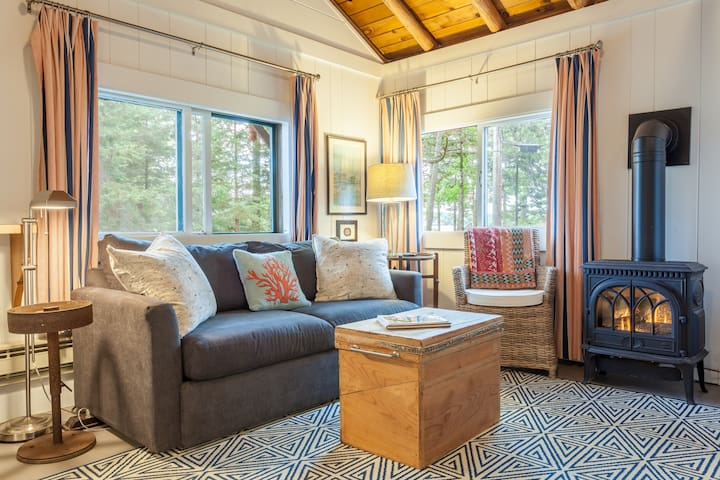 Large windows offer beautiful views of the surrounding woodland.