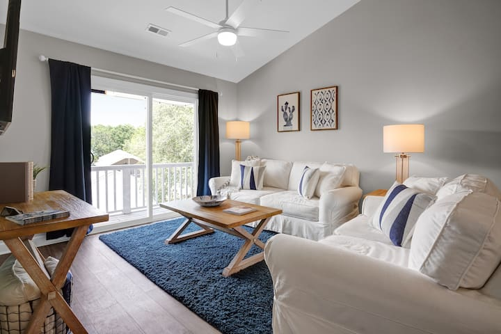 Inviting living space with modern slipcover couches for relaxing.