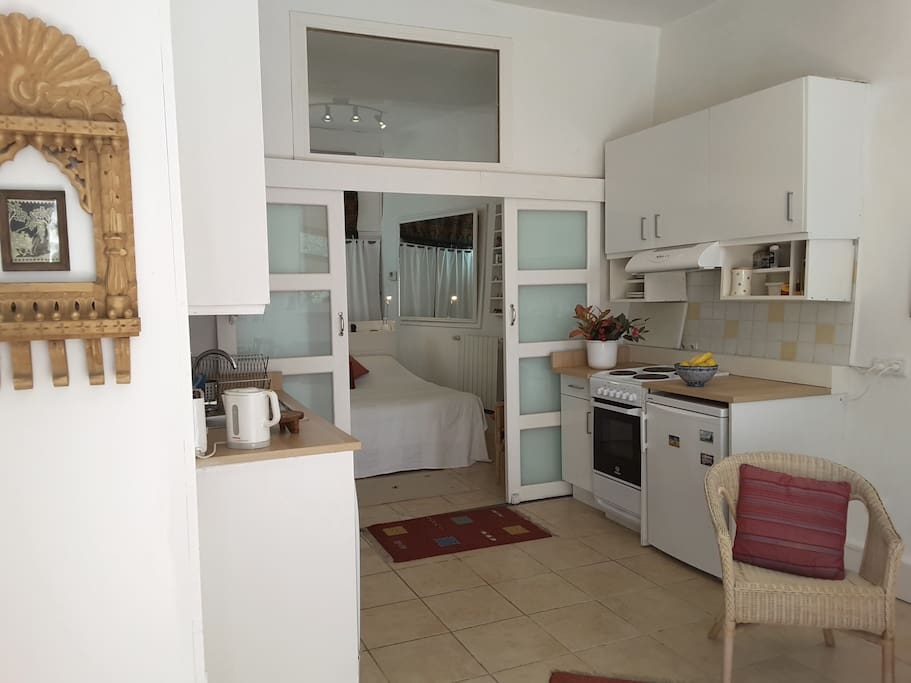 The kitchen of the Wing is fully equipped and has a cooker, fridge, washing machine and dishwasher