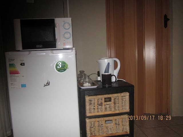 Fridge, microwave & crockery