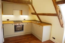 South wing, spacious fully equipped kitchen with a fridge and a dishwasher